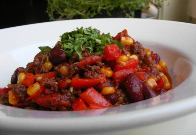 Manna from Heaven: Staming plates of chilli con carne are served at the Church of the Nazarene in Colingdale, Philadelphia. Picture: FootosVanRobin